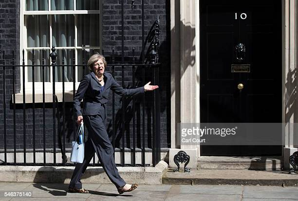 Prime Ministerinwaiting Theresa May reacts to photographers after walking to the wrong car after attending a Cabinet meeting at Downing Street on...