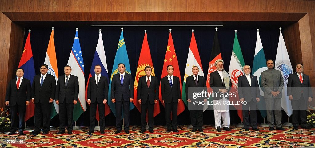 Prime Ministers of the nations, members of the Shanghai Cooperation Organization (SCO) and the top officials from the countries, which are Observer States and Dialogue Partners of SCO, pose for a family photo at a summit of the grouping at the Ala-Archa state residence in Bishkek on December 5, 2012. Shown (L-R) are: Mongolian Prime Minister Norov Altanhuyag, India's Deputy Foreign Minister Sanjay Singh, Uzbekistan's First Deputy Prime Minister Rustam Azimov, Russian Prime Minister Dmitry Medvedev, Kazakhstan's Prime Minister Serik Akhmetov, Kyrgyzstan's Prime Minister Zhantoro Satybaldiyev, Chinese Prime Minister Wen Jiabao, Tajikistan's Prime Minister Akil Akilov, Afghanistan's Deputy President Karim Halili, Iranian First Vice President Mohammad-Reza Rahimi, Pakistan's Minister of Information and Mass-Media Broadcast Qamar Zaman Kaira and (SCO) Secretary General Muratbek ImanaliyevThe top officials of a grouping led by Russia and China met today to discuss regional issues in the Kyrgyzstan's capital.