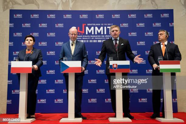 Prime ministers of the Visegrad group countries Poland's Beata Szydlo Czech Republic's Bohuslav Sobotka Slovakia's Robert Fico and Hungary's Viktor...