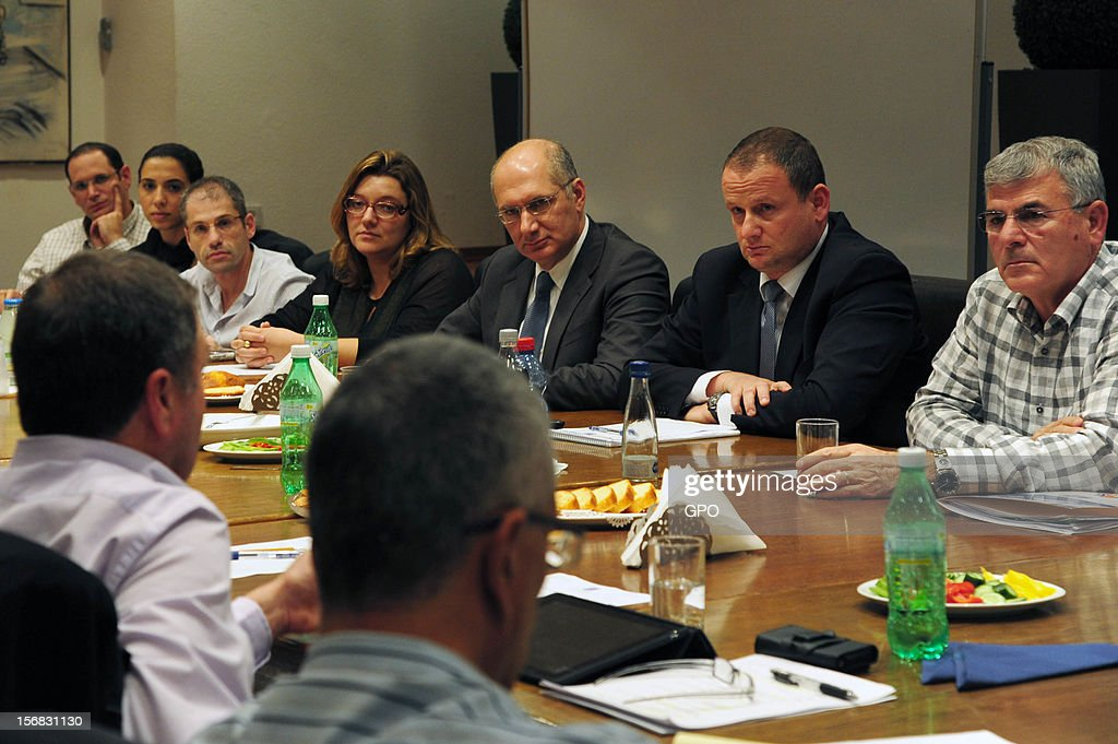 Prime Minister's Office Director-General Harel Locker (2R) meets with a team handling the recovery of cities and residents affected by the rockets fired from Gaza into southern Israel on November 22, 2012 in Tel Aviv, Israel. A ceasefire took hold on November 21 in and around Gaza after a week of cross-border violence between Israel and Palestinian militants, although a police spokesman reported that twelve rockets fired from the Gaza Strip hit Israel in the hours that followed the agreement.