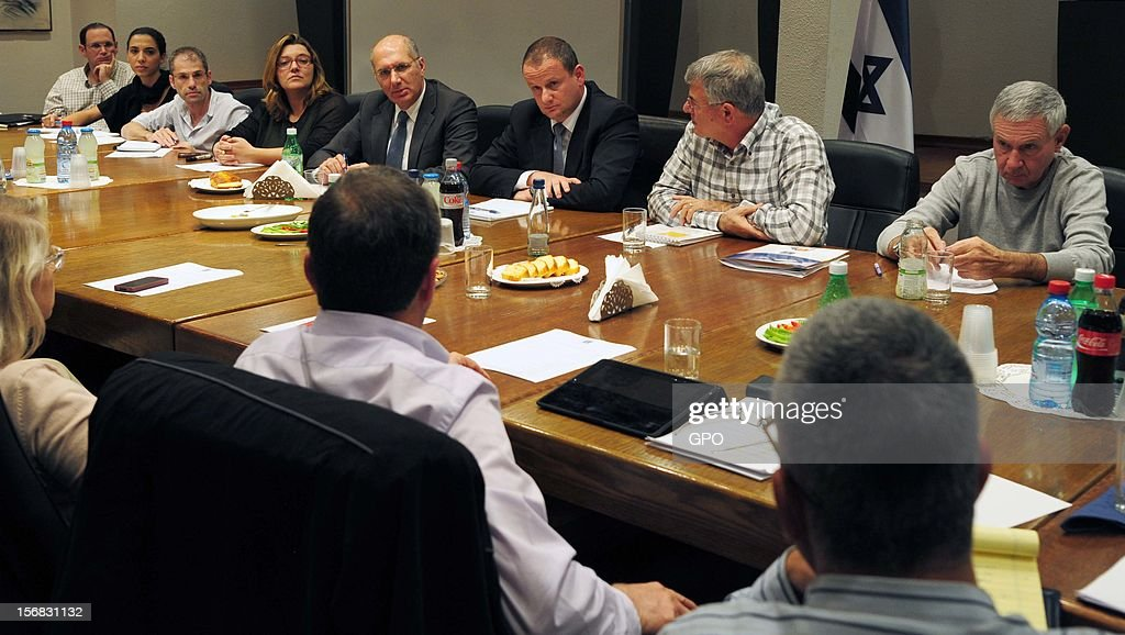 Prime Minister's Office Director-General Harel Locker (C) meets with a team handling the recovery of cities and residents affected by the rockets fired from Gaza into southern Israel on November 22, 2012 in Tel Aviv, Israel. A ceasefire took hold on November 21 in and around Gaza after a week of cross-border violence between Israel and Palestinian militants, although a police spokesman reported that twelve rockets fired from the Gaza Strip hit Israel in the hours that followed the agreement.