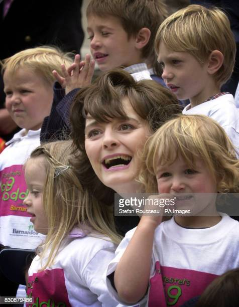 Prime Minister's wife and Barnardo's President Cherie Blair with children in Ladybird Montessori playgroup Highgate London to help launch the...