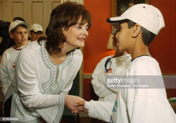 Prime Minister's wife Cherie Blair greets Fahdi ElHasam one of 15 young cancer sufferers from Israel that she met at No 10 Downing Street in London *...