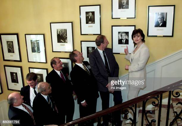 Prime Minister's wife Cherie Blair points out the portrait of former Labour Prime Minister Harold Wilson on the staircase at No10 Downing Street in...