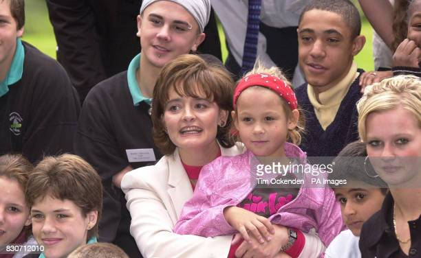 Prime Minister's wife Cherie Booth QC holds 10 year old April the youngest girl living at Barnardo's' High Close School Wokingham Ms Booth was made...
