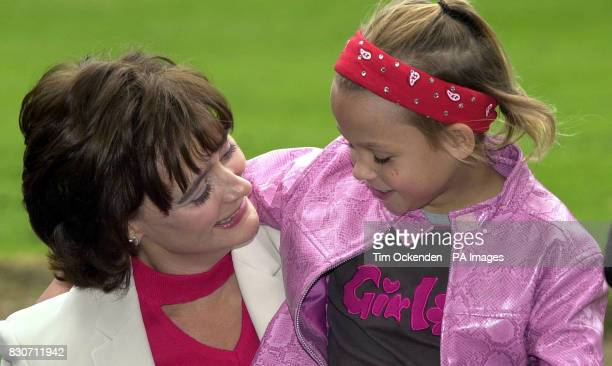Prime Minister's wife Cherie Booth QC with 10 year old April the youngest girl living at Barnardo's' High Close School Wokingham Ms Booth is...