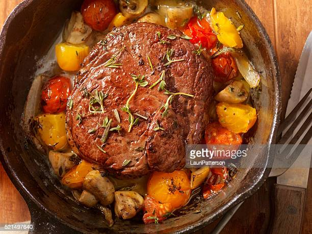 Prime Rib Steak with Tomatoes and Mushrooms