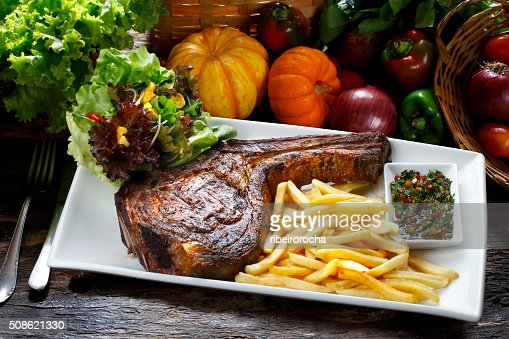 Prime rib with fries and salad : Stock Photo