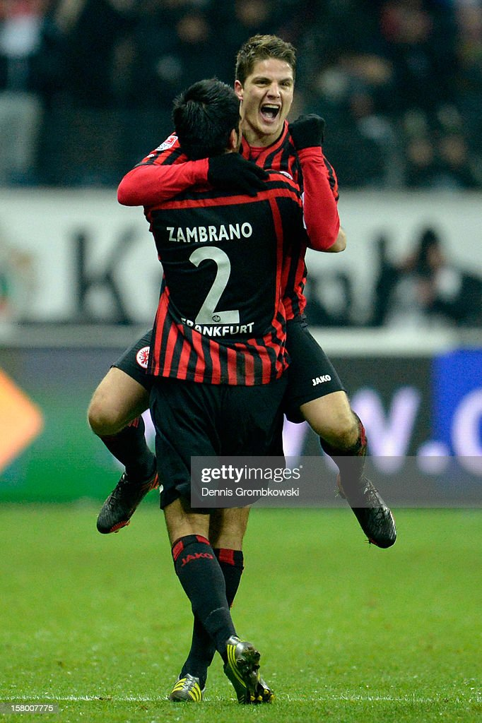 Primin Schwegler of Frankfurt celebrates with teammate <a gi-track='captionPersonalityLinkClicked' href=/galleries/search?phrase=Carlos+Zambrano&family=editorial&specificpeople=203225 ng-click='$event.stopPropagation()'>Carlos Zambrano</a> after scoring a goal during the Bundesliga match between Eintracht Frankfurt and SV Werder Bremen at Commerzbank-Arena on December 8, 2012 in Frankfurt am Main, Germany.