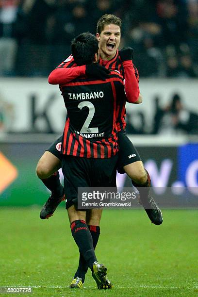 Primin Schwegler of Frankfurt celebrates with teammate Carlos Zambrano after scoring a goal during the Bundesliga match between Eintracht Frankfurt...