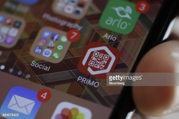 Primo Inc's mobile payment application icon is displayed on the screen of a smartphone at the Primo Express unattended virtual popup store in Tokyo...