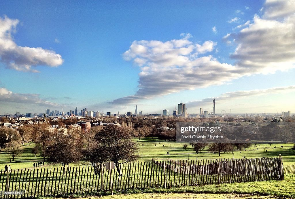 Primrose Hill In Front Of Buildings Against Cloudy Sky