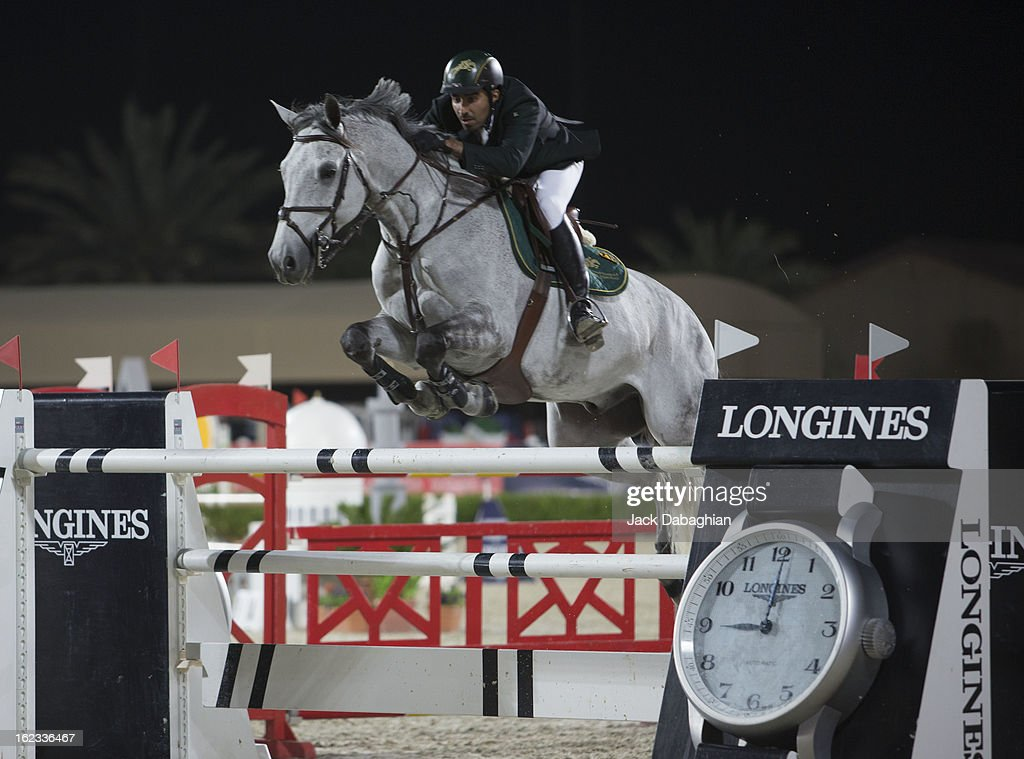 Prince Abdullah Al Saud of Saudi Arabia clears a hurdle on Davos during the President of the UAE Showjumping Cup - Furusyiah Nations Cup Series presented by Longines on February 21, 2013 in Al Ain, United Arab Emirates.