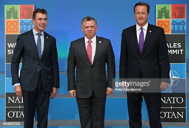 Prince Abdullah of Jordan stands with NATO Secretary General Anders Fogh Rasmussen and British Prime Minister David Cameron at the NATO Summit on...