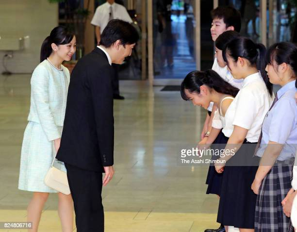 Prince Akishino and his second daughter Princess Kako are greeted after attending the opening ceremony of the 41st All Japan High School Cultural...