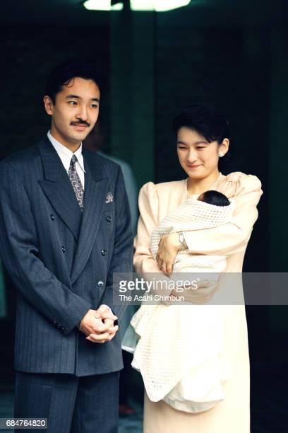 Prince Akishino and Princess Kiko holding their daughter Princess Mako are seen on departure at the Imperial Household Agency Hospital on November 1...