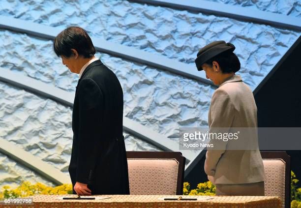 Prince Akishino and Princess Kiko observe a moment of silence during a governmentsponsored memorial service in Tokyo on March 11 the sixth...
