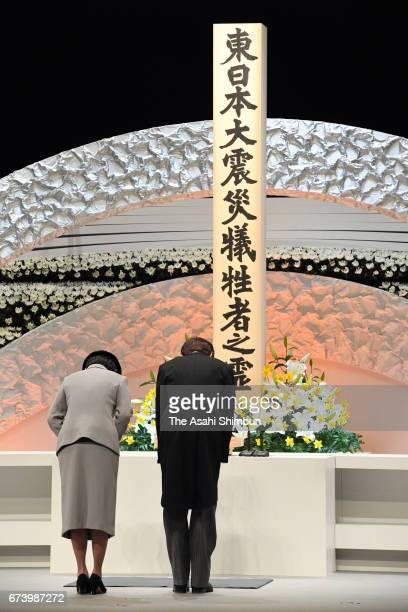 Prince Akishino and Princess Kiko of Akishino bow toward an altar during the memorial ceremony on the sixth anniversary of the Great East Japan...