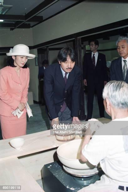 Prince Akishino and Princess Kiko of Akishino inspect the venue of the World Ceramics Exposition on July 18 1996 in Arita Saga Japan