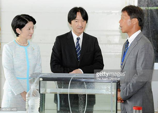Prince Akishino and Princess Kiko of Akishino listen to an explanation after attending the Umi Festa Kyoto opening ceremony on July 24 2014 in...