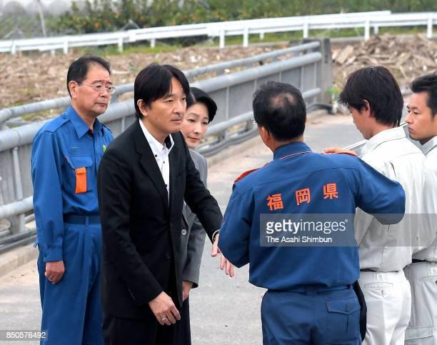 Prince Akishino and Princess Kiko of Akishino listen to the explanation of the damage of torrential rain on September 21 2017 in Asakura Fukuoka Japan