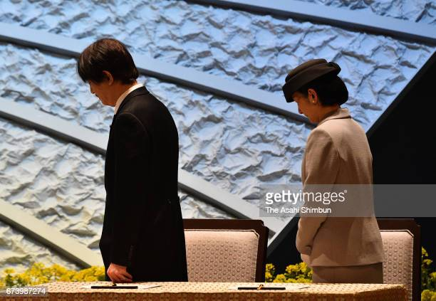 Prince Akishino and Princess Kiko of Akishino observe a minute of silence during the memorial ceremony on the sixth anniversary of the Great East...