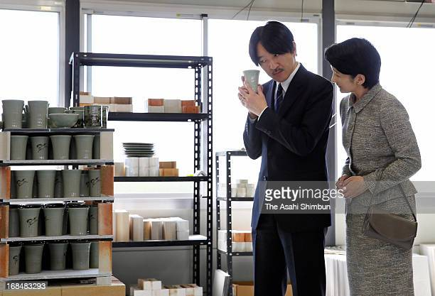 Prince Akishino and Princess Kiko of Akishino visit a pottery during their visit to Fukushima prefecture on May 9 2013 in Nihonmatsu Fukushima Japan