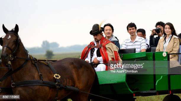 Prince Akishino and Princess Mako of Akishino are seen on a coach during their visit to a farm on August 20 2017 in Bugac Hungary Princess Mako elder...