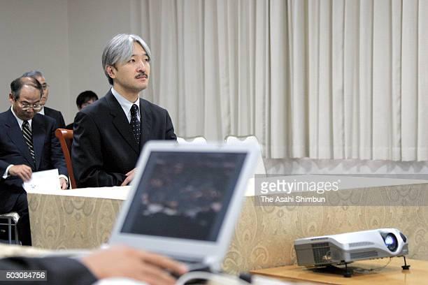 Prince Akishino listens to the explanation on the Japanese cormorant hunting during his visit to Ibaraki on October 6 2006 in Hitachi Ibaraki Japan