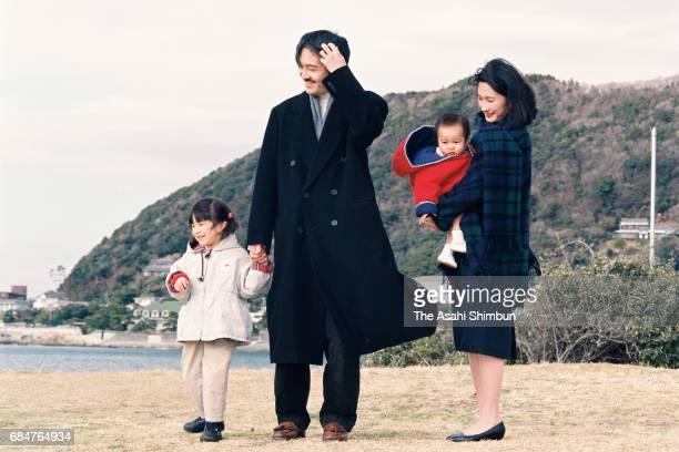 Prince Akishino Princess Kiko and their daughters Princess Mako and Kako stroll outside the Hayama Imperial Villa on January 26 1996 in Hayama...