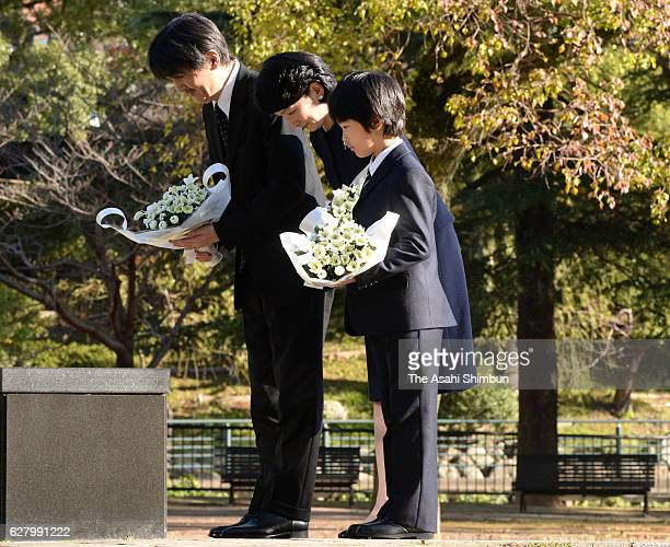 Prince Akishino Princess Kiko and their son Prince Hisahito offer flowers at the Abomb Hypocenter Memorial at Nagasaki Hypocenter Park on December 6...