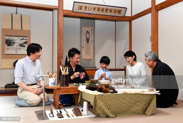 Prince Akishino Princess Kiko of Akishino and Prince Hisahito visit ink brush manufacturer 'Hankeido' on August 10 2017 in Takashima Shiga Japan