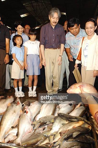 Prince Akishino Princess Kiko Princess Mako and Kako visit a local fish market during their visit to Thailand on August 12 2003 in Ubon Ratchathani...