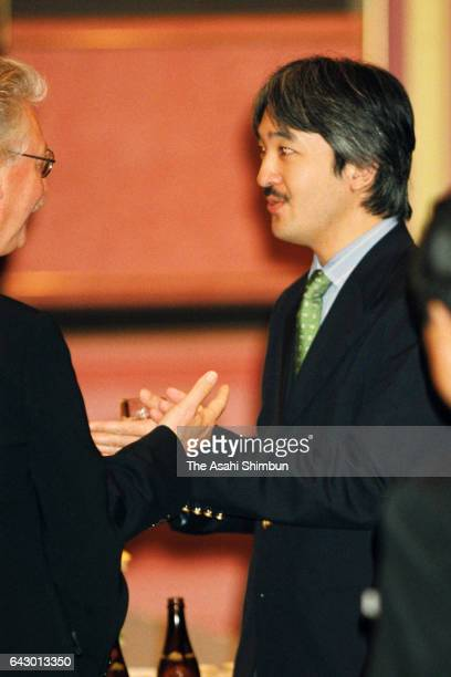 Prince Akishino talks with participants during the reception of the World Association of Zoos and Aquariums Congress on October 13 1998 in Nagoya...