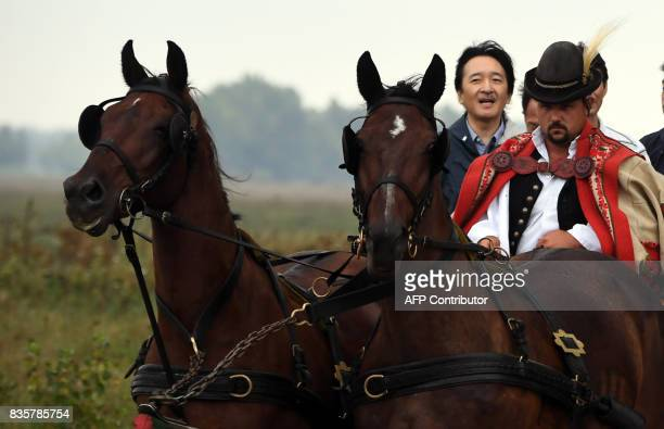 Prince Akishino the 2nd son of Japan's emperor Akihito is transported by a local horsecarriage at Bugac Puszta about 100 km south from Hungarian...