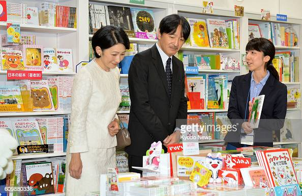 Prince Akishino the younger son of Japanese Emperor Akihito and his wife Princess Kiko are briefed by a staffer at the Tokyo International Book Fair...