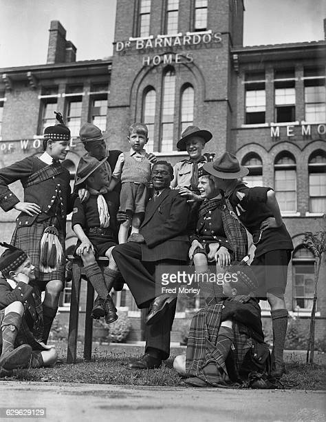 Prince Akitoi of the Congo with boys from Dalziel of Wooler House a Barnardo's children's home in Kingston upon Thames Surrey 24th July 1943 Dalziel...