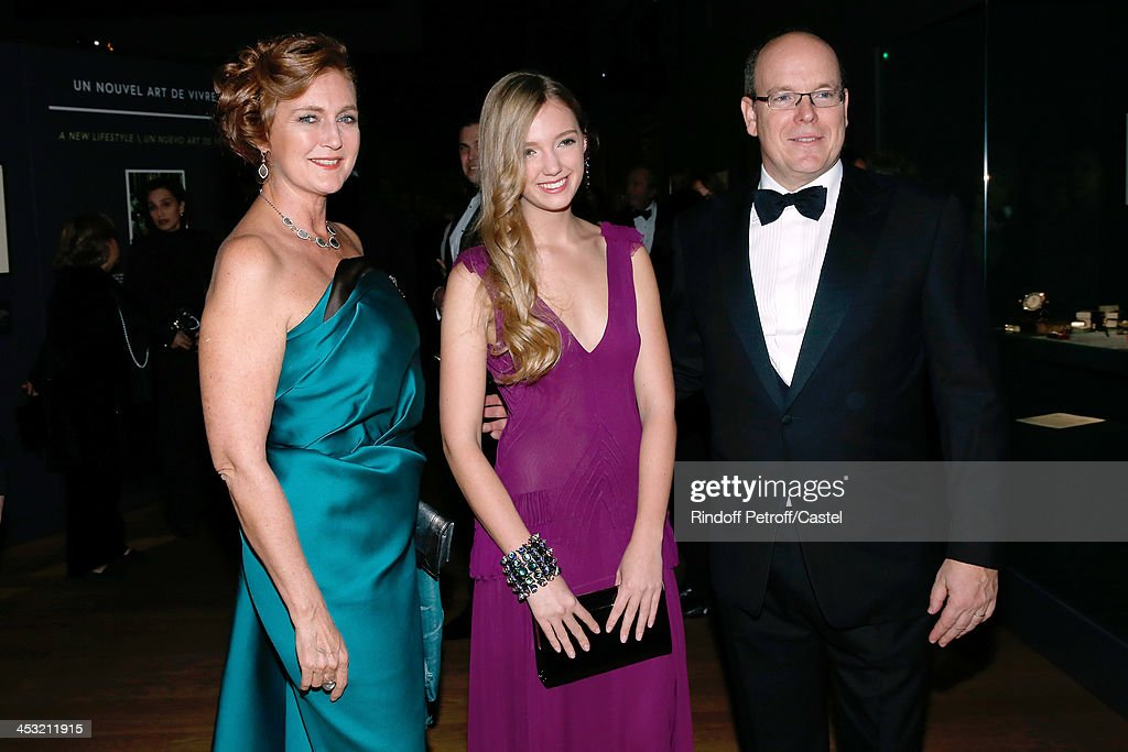 Prince Albert de Monaco (R), Archduchess Eleonore Von Habsburg and her daughter Princess Francesca Von Habsburg attend the 'Cartier: Le Style et L'Histoire' Exhibition Private Opening at Le Grand Palais on December 2, 2013 in Paris, France.