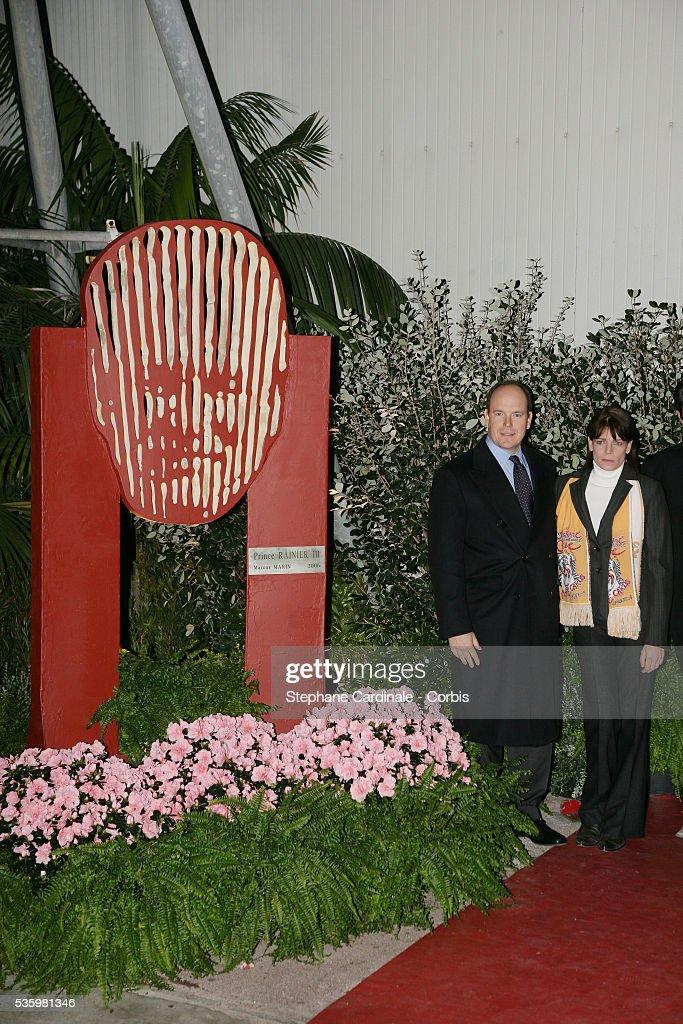 HRH Prince Albert II and HRH Princess Stephanie of Monaco stand beside the sculpture of Prince Rainier III, created by artist Marco Marin.