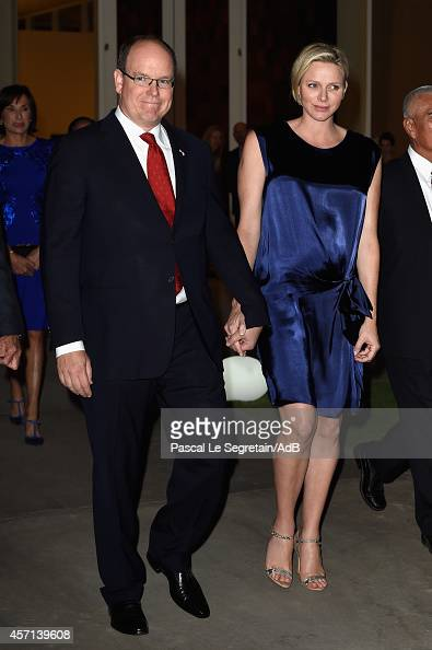 Prince Albert II and Princess Charlene of Monaco arrive to attend 'Prince Albert II of Monaco's Foundation' Award Ceremony on October 12 2014 in Palm...