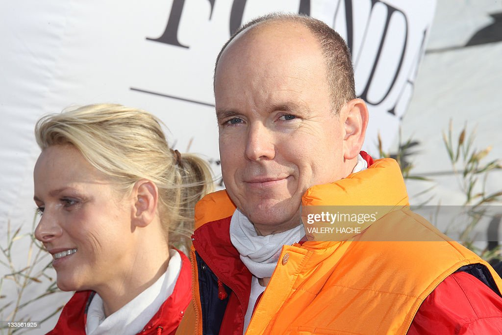 Prince Albert II (R) and princess Charlene of Monaco (L) pose at the end of the 'No Finish Line' charitable running race, on November 20, 2011 in Monaco. Every kilometre completed, either by running or walking, means 1 euro donated to the nominated charities which include the Cardio-Thorasic Centre in Monaco, Fight AIDS Monaco, Hospital Cheick Zaied in Mauritius and the construction of a new school in Segou in Mali.