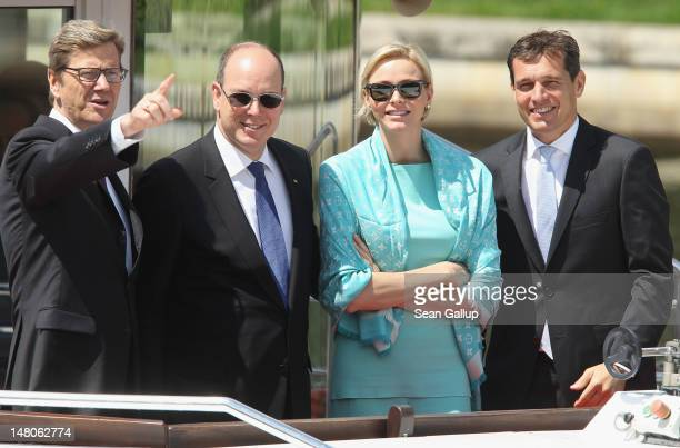 Prince Albert II and Princess Charlene of Monaco ride a boat with German Foreign Minister Guido Westerwelle and his partner Michael Mronz on the...