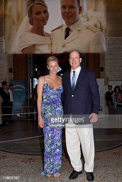 Prince Albert II and Princess Charlene of Monaco visit 'History Of The Princely Wedding' Exhibition at Musee Oceanographique on July 21 2011 in...