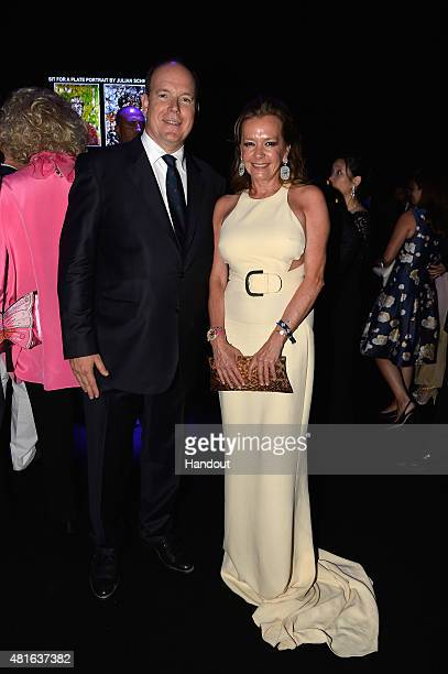 Prince Albert II of Monaco and Caroline Scheufele pose as they attend a cocktail reception during The Leonardo DiCaprio Foundation 2nd Annual...