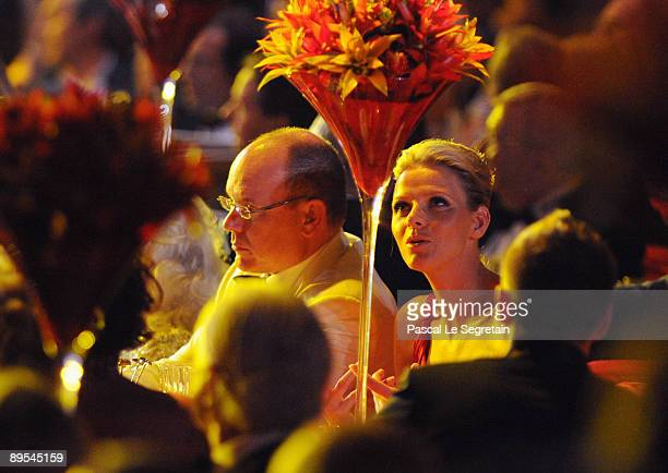 Prince Albert II of Monaco and Charlene Wittstock attend the 61st Monaco Red Cross Ball at the Monte Carlo Sporting Club on July 31 2009 in Monte...