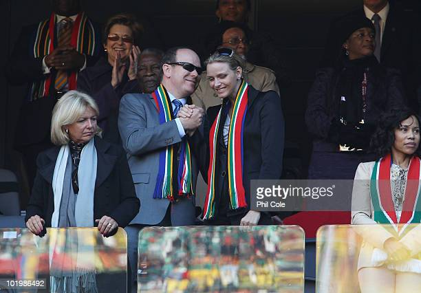 Prince Albert II of Monaco and his girlfriend Charlene Wittsock attend the 2010 FIFA World Cup South Africa Group A match between South Africa and...