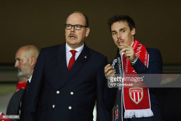 Prince Albert II of Monaco and his nephew Louis Ducruet attend the UEFA Champions League group stage football match between Monaco and Besiktas on...