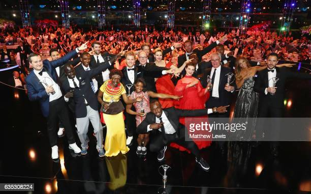 Prince Albert II of Monaco and his wife CharlenePrincess of Monaco and Laureus World Sports Awards winners pose for a selfie on stage during the 2017...