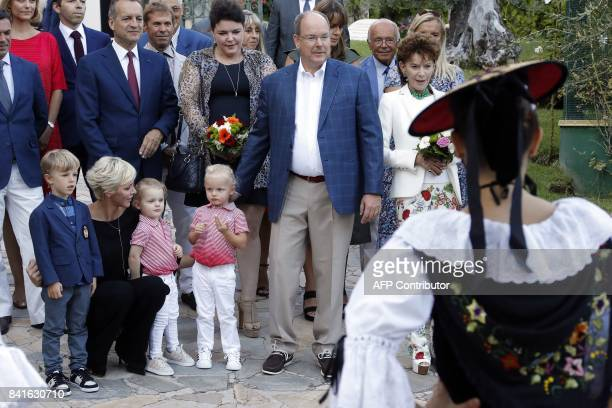 Prince Albert II of Monaco and his wife Princess Charlene arrive with their twins Prince Jacques Princess Gabriella and an unidentified child to take...