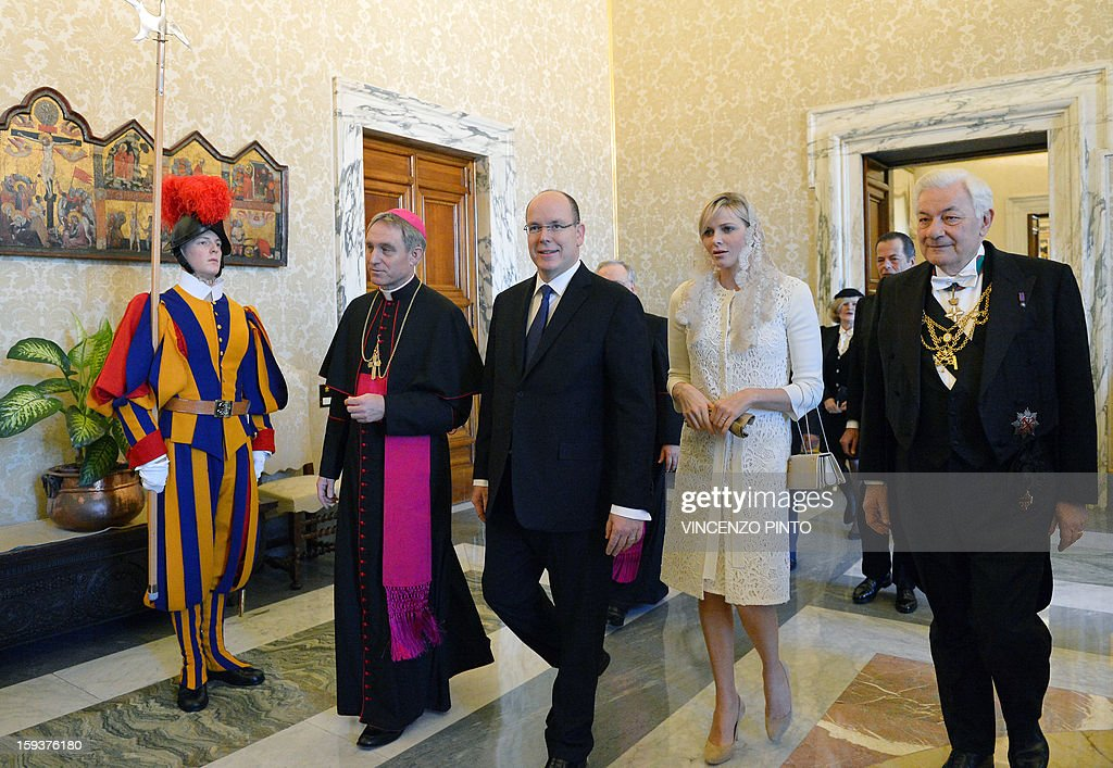Prince Albert II of Monaco and his wife Princess Charlene arrives on January 12, 2013 to a private audience with Pope Benedict XVI at Vatican. AFP PHOTO / VINCENZO PINTO